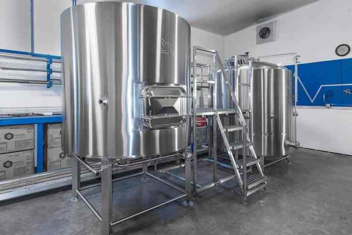 Example of a brewhouse comprised of a Mash/Lauter tun, platform, and brew kettle.