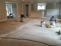 Starting the installation of the wood flooring.