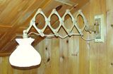 Swing arm lamp extenders