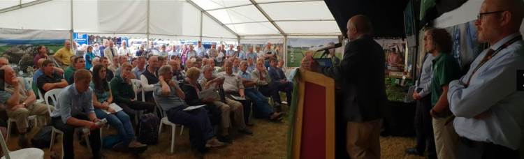 Large Audience in a marque listing to presentations at Green Gold event prganised by Confor