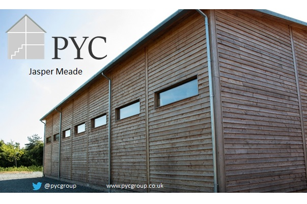 First slide for a power point presentation showing PYC factory covered in timber cladding