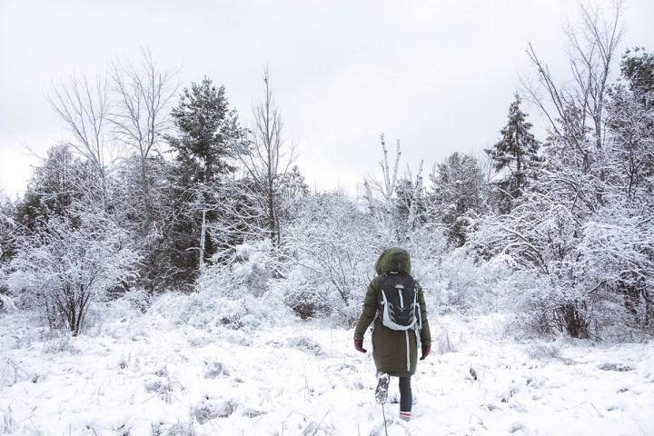 Woman walks in the winter snow