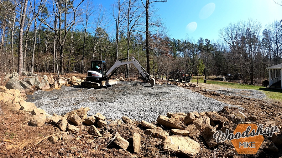 Spreading gravel for outdoor living space