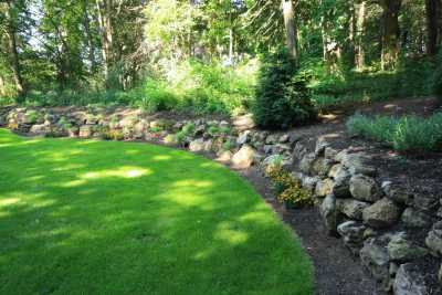 Boulder Retaining wall used for Landscape Renovation Rochester NY