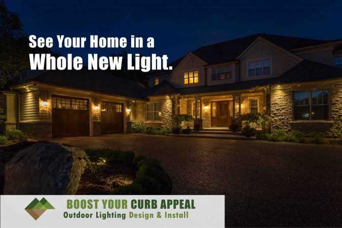 Outdoor lighting installed in front yard landscape adding curb appeal after dark
