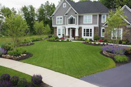 Beautiful front yard landscaping designed for low maintenance curb appeal Adds to home value