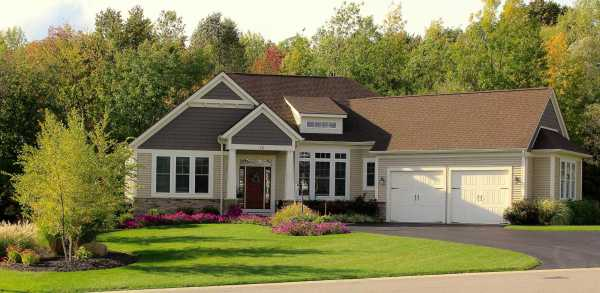 well designed front yard landscaping. Bed on left balances the look of garage. Fixes the curb appeal. Adds value to home.
