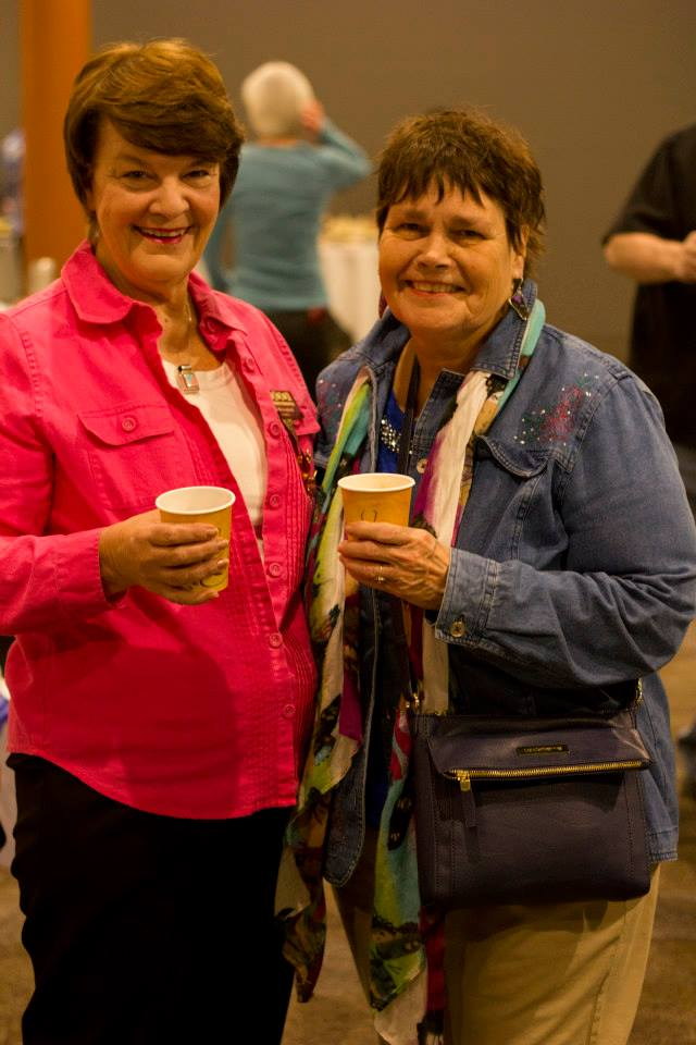 Happy visitors in a theater lobby DOWNTOWN GLENS FALLS THEATER