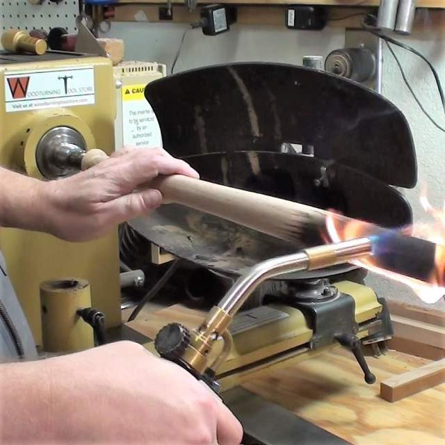 torching a woodturning tool handle