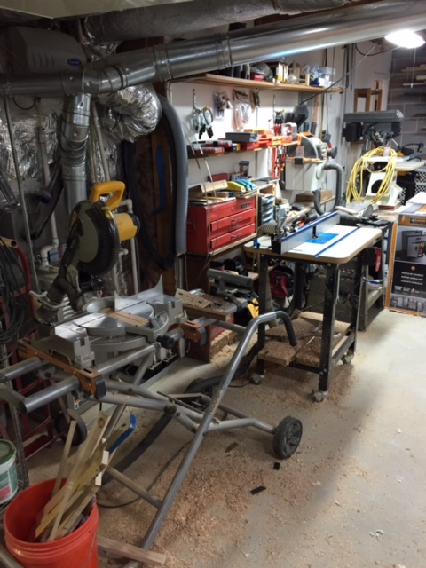 This is the front of my shop showing my DeWalt chop saw, Rockler router table with their FX lift and Porter Cable 890 router and Kreg fence, old Craftsman sander, Jet spindle sander, Porter Cable drill press, and way on the far end a recently purchased DeWalt scroll saw.