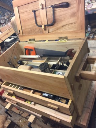 I started on this before I found Mr. Seller's tool chest video, but it is similar. Maple and Cyprus. I'm 17 and this was my first project to use almost no metal fasteners. Thank you Mr. Sellers!