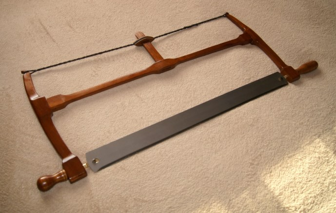 """A 22"""" blade frame saw, salvaged mahogany, finished with button polish."""