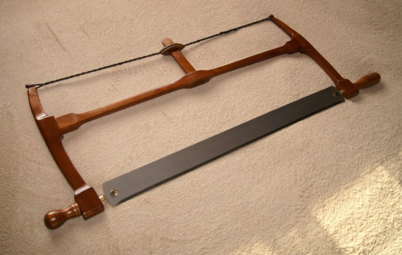 "A 22"" blade frame saw, salvaged mahogany, finished with button polish."