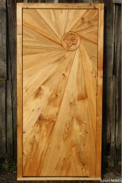 I promised a door for a friend and he didn't know which design I had in mind. I tried to design it to mimic his way of life (and mine too). So there is the Sun door.