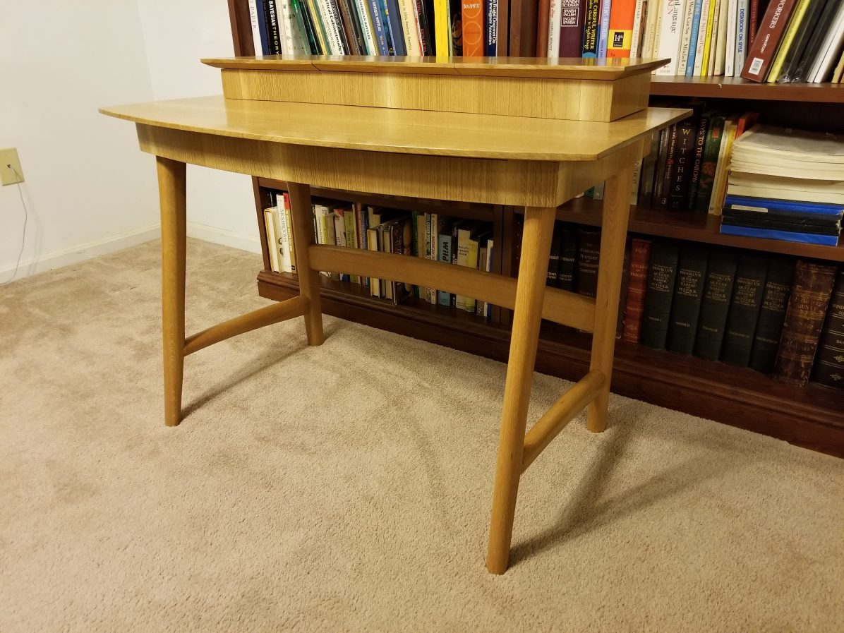 """Used quarter-sawn white oak. To form legs I made a jig by drawing a center line on a 5"""" cutoff from a 2 X 4, drilling a 1 1/2"""" hole in the middle, ripping down the center line, gluing the two halves together, and trimming up with a plane. I put sandpaper in the 1 1/2 channel thus formed."""