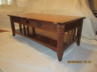 Arts and crafts style coffee table made of black walnut and Cumaru.