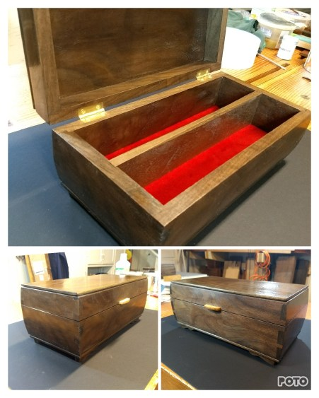 I made six boxes based on Paul's design. Here's one in walnut. I varied the feet and added a lift for the lid made from plum.