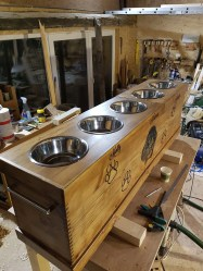 This dog feeder is made out of pine. Carving is done with a cnc.