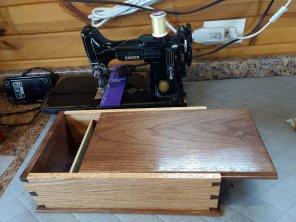 Dovetail box of White Oak and Black Walnut. I made it for my wife to store her manuals, tools and foot pedal for her Singer Featherweight sewing machine that she pieces all her quilts with.
