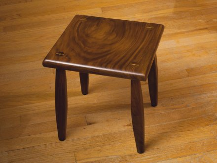 Black walnut footstool finished with blonde shellac. I used maple for the wedges to add a little contrast. The first piece of furniture I've made.