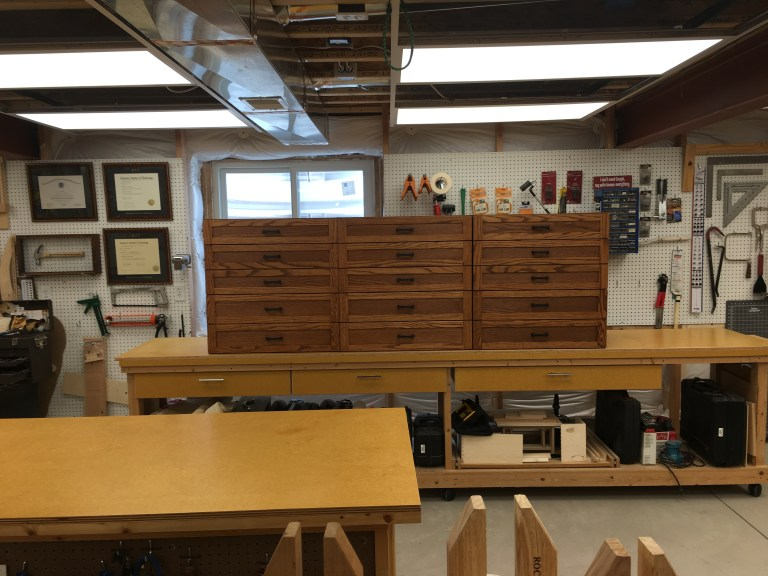 Red oak and red oak plywood. Mostly used jointer, smoother and hand-router. Craftsman style faced drawers and panels. Drawers are made of 1/2 Russian Birch. Finish is stain and tungsten oil.