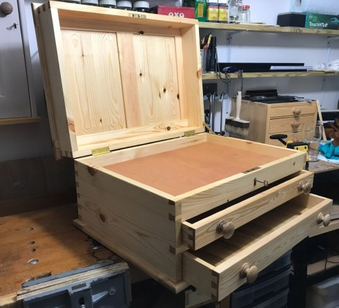 Toolchest built from pine and finished with Tung Oil. I treated myself to a Brusso box lid stay.