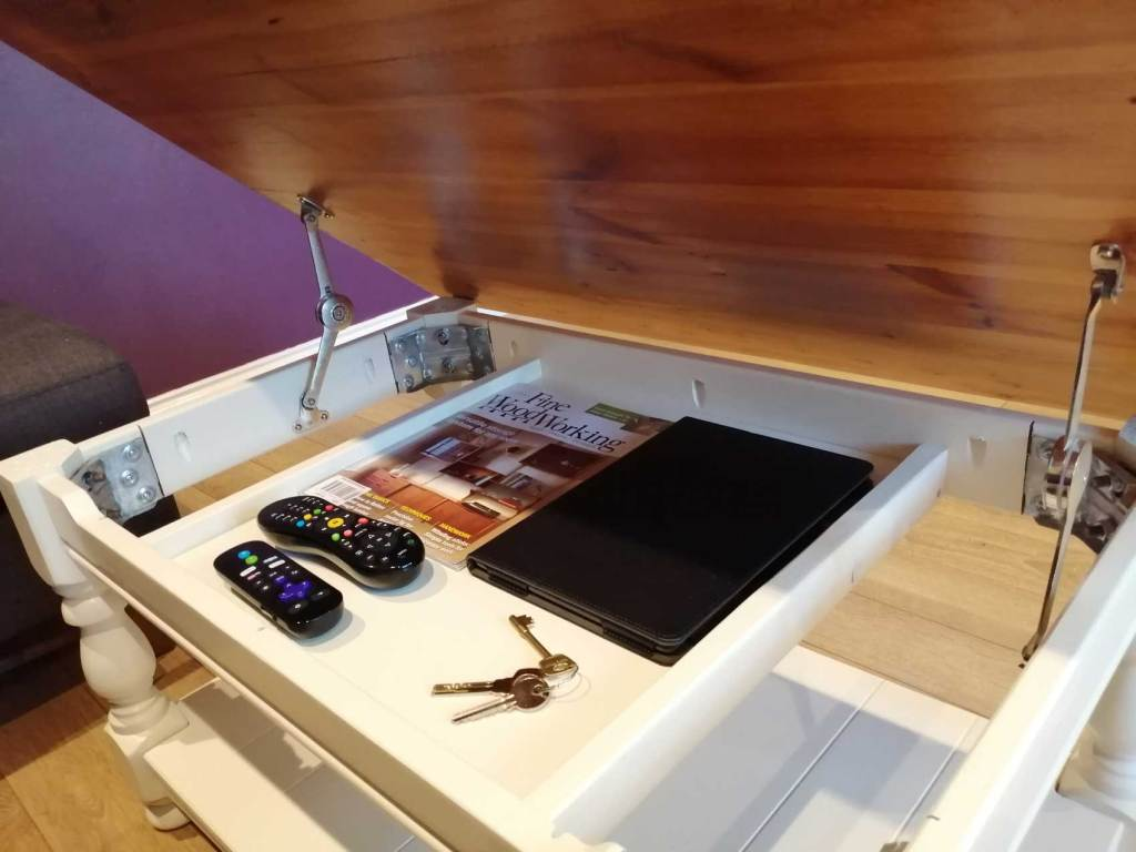 Upcycled coffee table with hinged top
