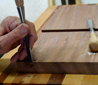 Small chisel to remove waste by cutting end grain