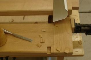Cutting slot for adjustment bolt