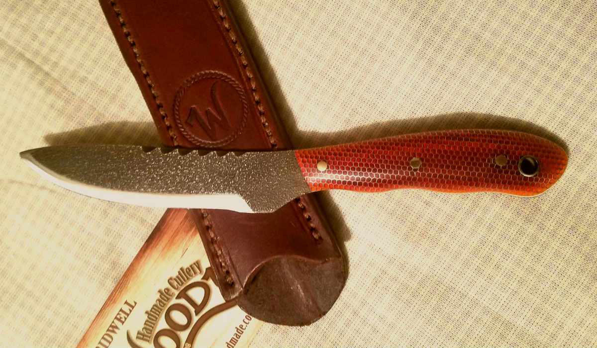 "A custom knife with handle material ""orange honey comb"""