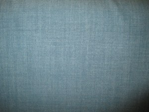 Swatch of Pendleton wool fabric in a blue chambray weave.