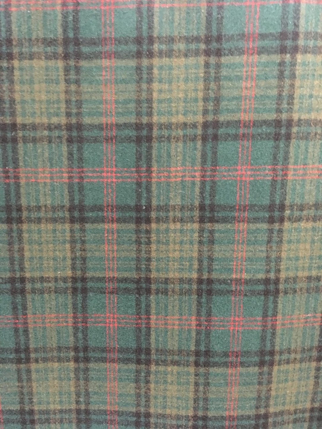 Swatch of Pendleton wool fabric in Ross Hunting Tartan, which is a coral, yellow and taupe plaid on a moss green background.