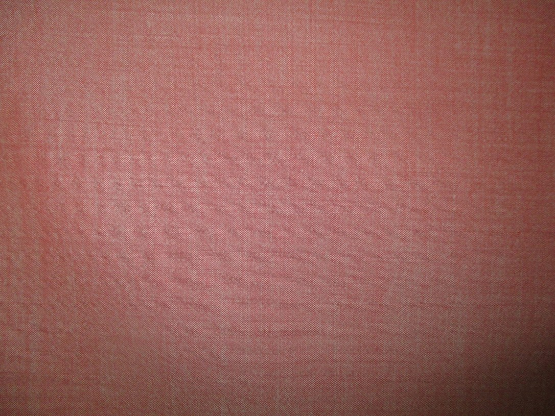 Swatch of Pendleton wool fabric in a red chambray weave.