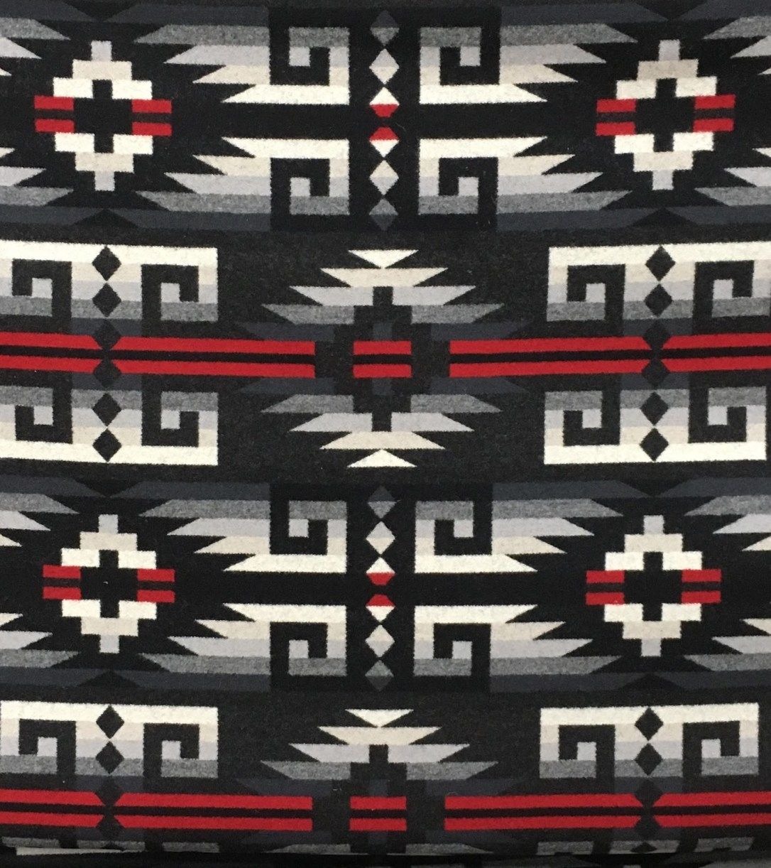 swatch of Pendleton wool fabric in Rio Rancho Black, a black, red and cream colored fabric with geometric shapes.