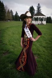 Young Western pageant princess wearing a cowboy hats and gown made of Pendleton wool and burgundy velvet.