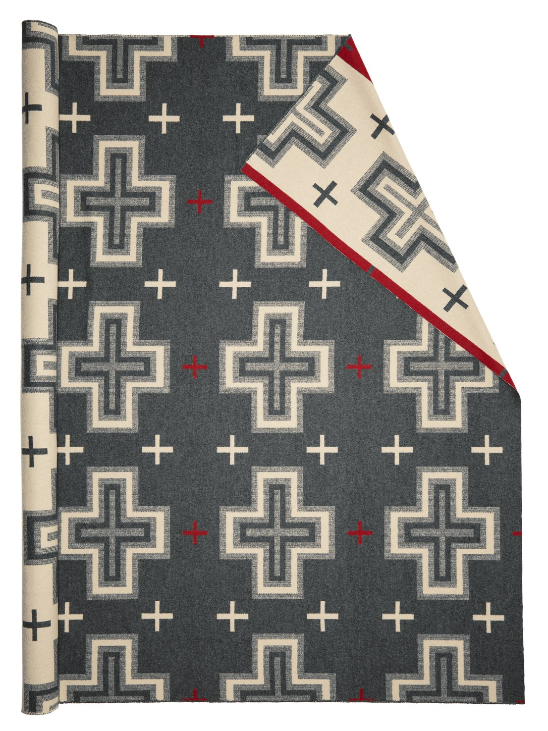 Roll of pendleton wool fabric in San Miguel, grey background with large ivory crosses and small red crosses.