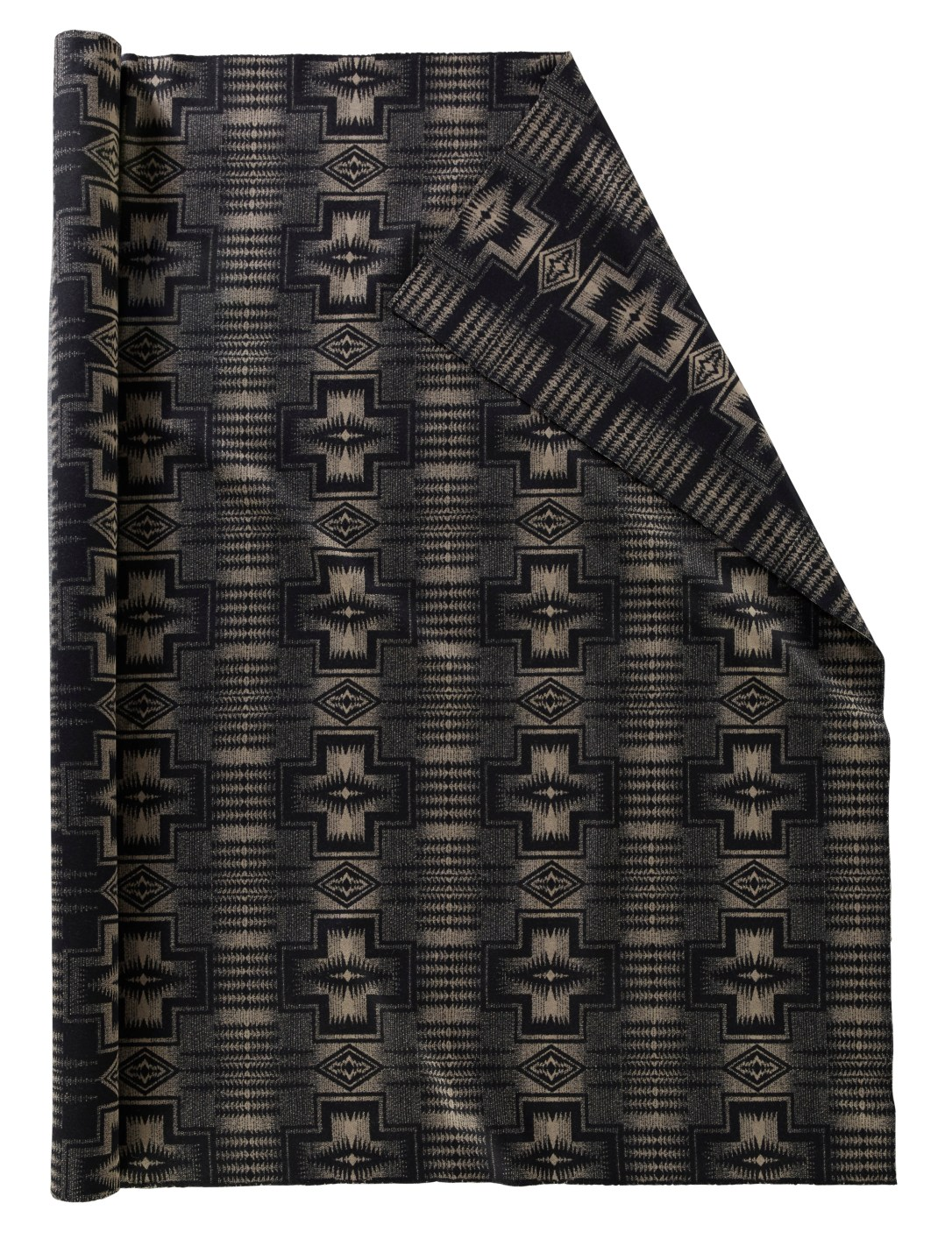 A roll of Pendleton wool fabric in Harding Black and Tan, a pattern with crosses and small chains of arrows in mostly black with accents of a greyish-tan.