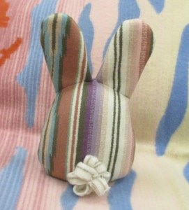back view of striped rabbit--tail is made from wooly worm