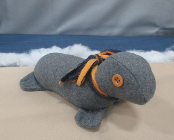 A toy stuffed seal made of grey Pendleton Eco-Eise Wool