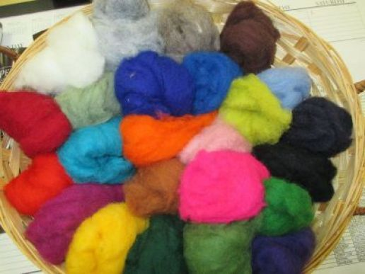 a basket of soft Colorplay wool in a rainbow of colors