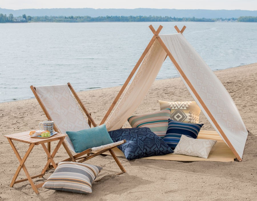 Sunbrella fabrics made into pillows, tent and chair, set up on the beach!