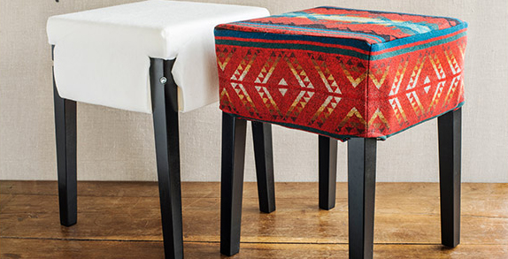 Photo of two stools, one covered in white muslin, the other covered with a slipcover made of Pendleton wool.