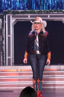 Miss Rodeo Oregon, Taylor Ann Skramstad, addresses the crowd in jeans, with a jacket and boots embellished with Pendleton wool accents.