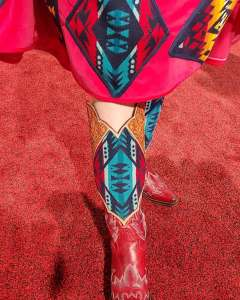 Taylor Ann Skramstad shows off her red cowboy boots, embellished with Pendleton wool.