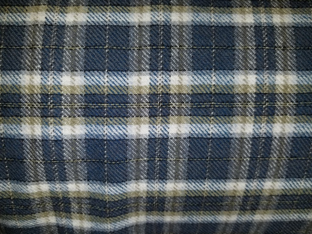 Twill weave woolen fabric in a blue/white/grey plaid
