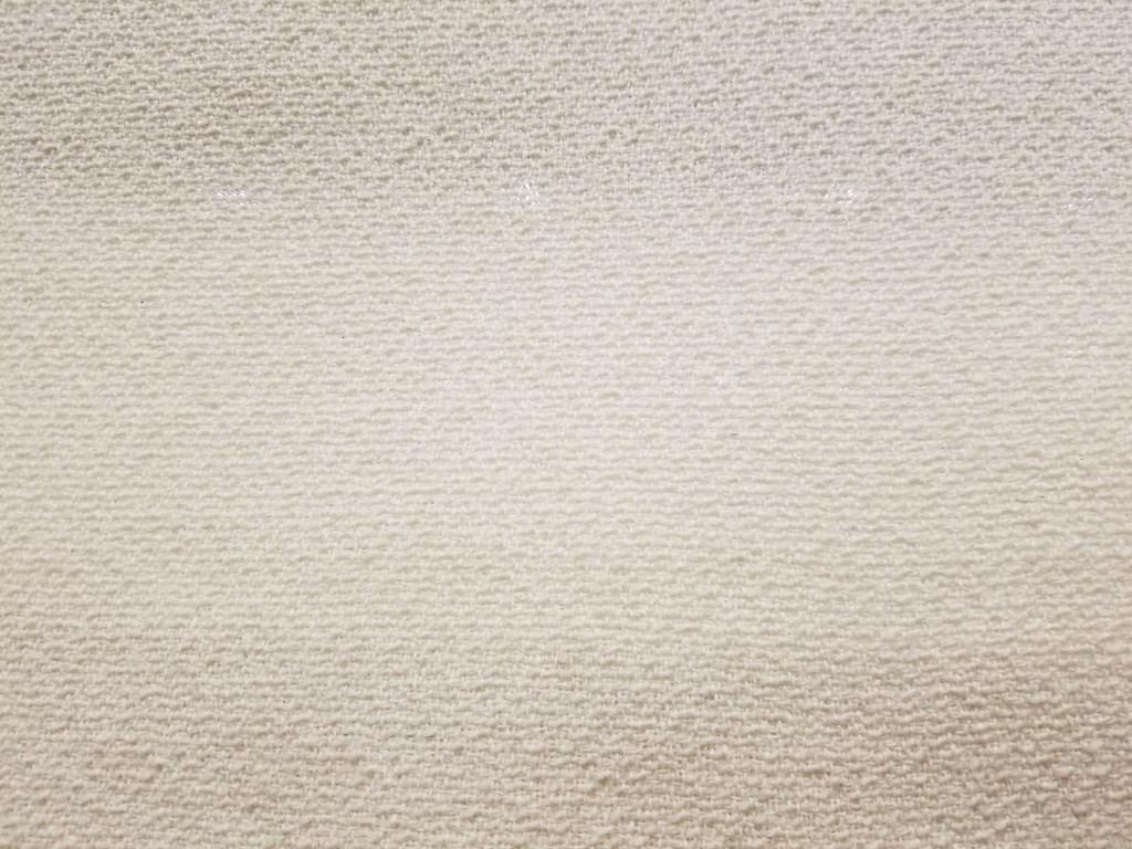 Greige wool fabric in a twill weave