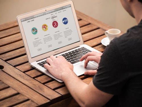 Description: Person Typing on Macbook Air