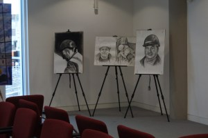 Pencil drawings of miners on easels