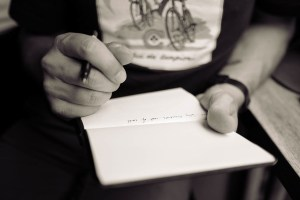 Creative writer with notebook and pen