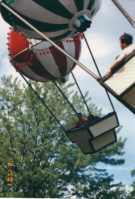 amusement park ride with balloon baskets